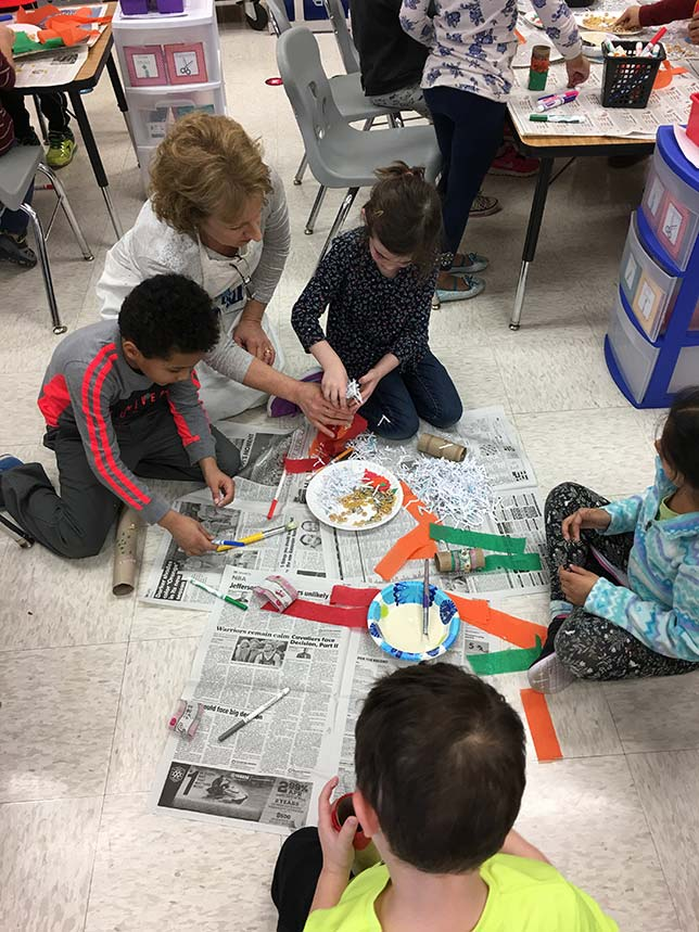 Kindergartners in Loudoun County work on games designed to stimulate the minds of orangutans.